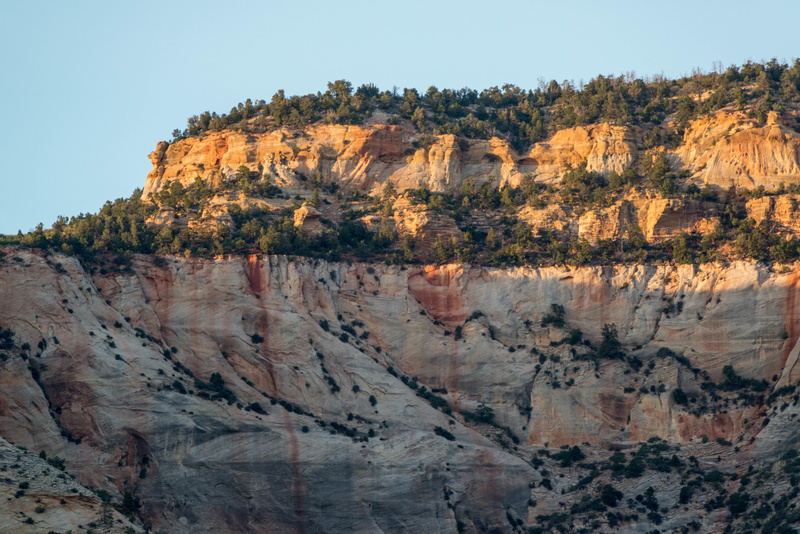 Sun setting on east wall of Zion Canyon north of Zion Lodge