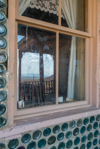 Reflections of the front porch on the front window. by...