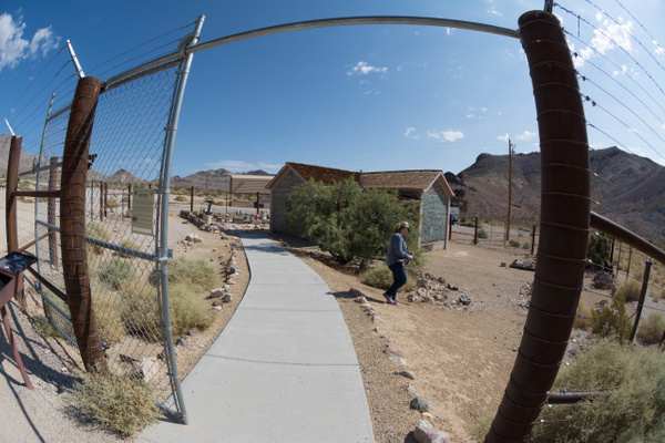 Tom Kelly's Bottle House is behind barbed wire to keep...