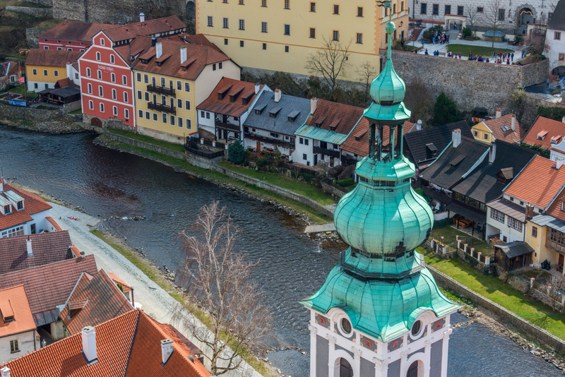 Hotels and restaurants along the south bank of the Vltava. Steeple of St. Jost Church in front.