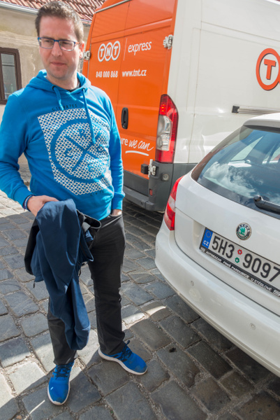 Our driver, Dusan, checks to make sure parking is...