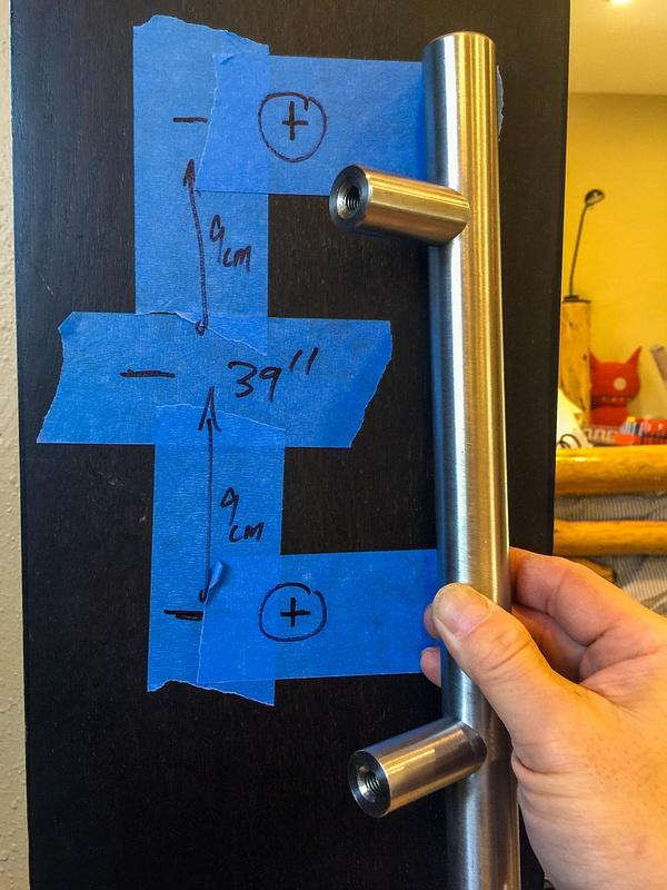 Marking holes for tubular steel barn door handle. Mix of English and Metric measurements.
