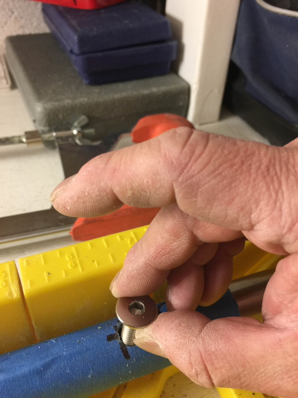 Making sure the anchoring bolt will fit into the new hole.