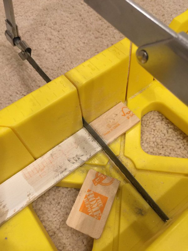 Making shims out of paint stir sticks. I also used popsicle sticks bought in the paint section.