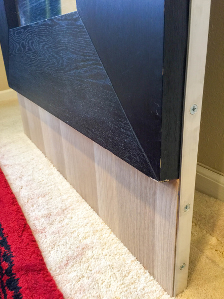 Assembled door with white oak footer panel held to...