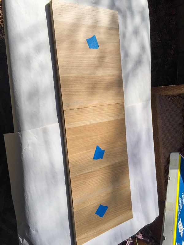 Test fitting the cut Askvoll veneer panels on the header board.