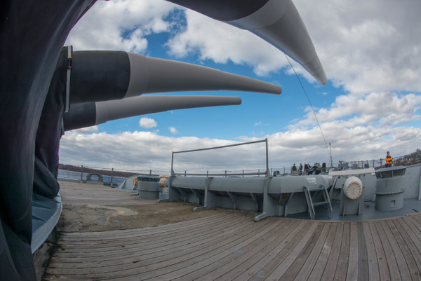 Under the 16 inch guns of Turret 1 looking forward. by...
