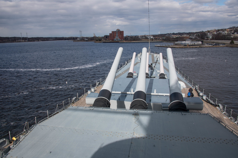 On the deck just above the tops of the main gun turrets.
