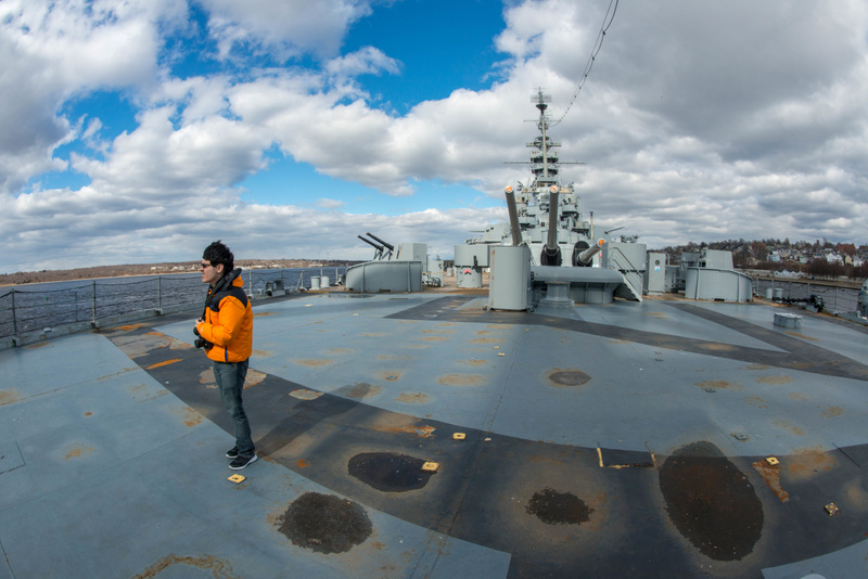 Ben bracing against the cold wind on the fantail of the USS Massachusetts.