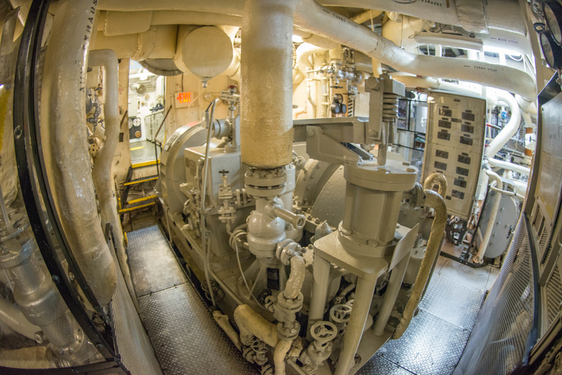 Into the engineering spaces aboard the Joe Kennedy. This looks like a steam-driven generator.