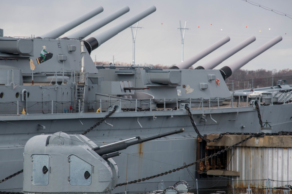 The Hiddensee's 76 mm AK-176 gun turret with the USS...