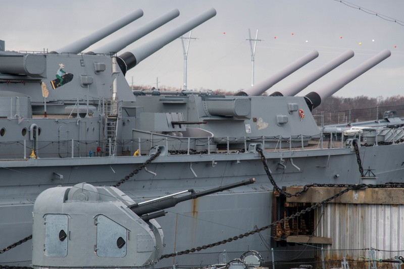 The Hiddensee's 76 mm AK-176 gun turret with the USS Massachusetts' 16 inch forward turrets behind.