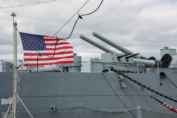 Still a nice photo with the flag on the fantail of the...