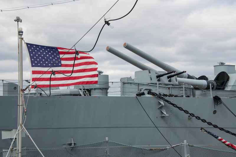 Still a nice photo with the flag on the fantail of the Joe Kennedy and the rear 16 inch guns on BB59