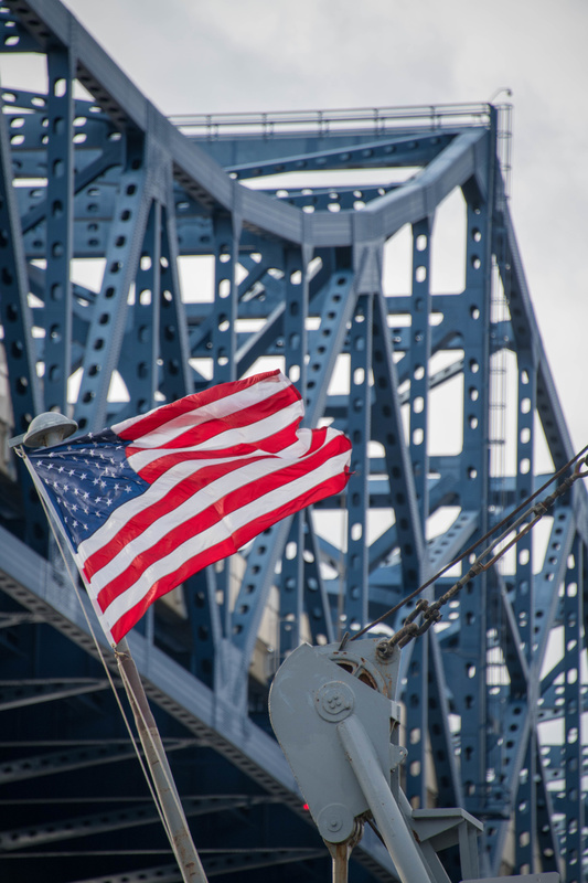 Flag in the fantail of the Joe Kennedy, looking at the bridge over the Taunton River.
