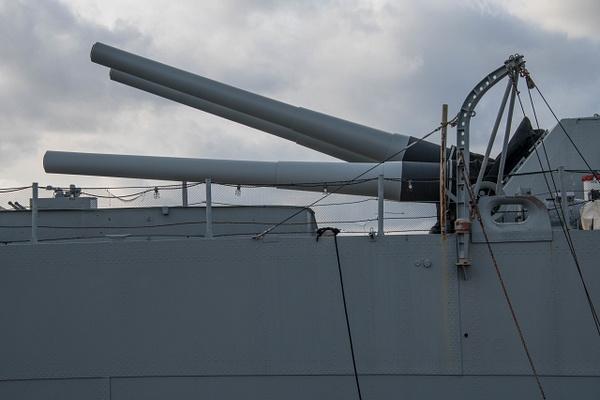 Triple 16 inch main guns in the single rear turret on...