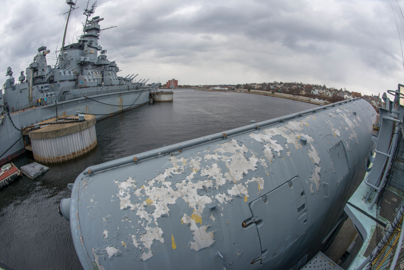 View of the USS Massachusetts over the port Styx missile launchers on the Hiddensee.