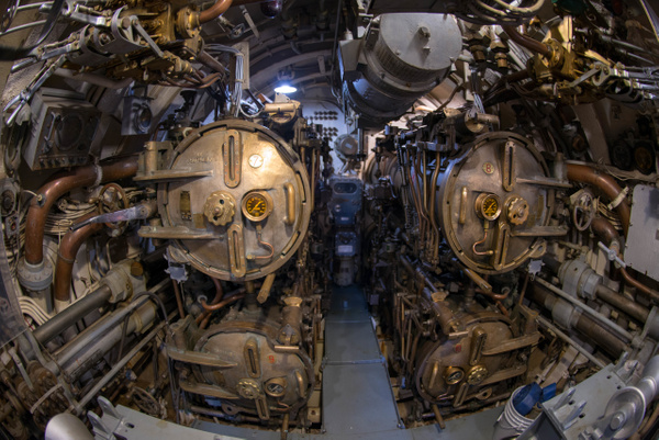 Torpedo tubes in the aft torpedo room of the USS...