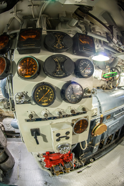 A generator status panel in the engine room of the USS...