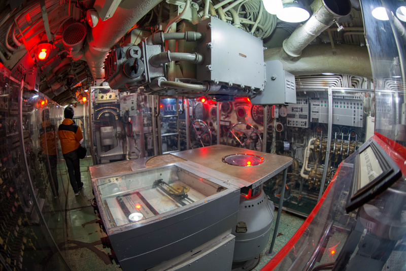 Control room of the USS Lionfish, with dive plane controls on far wall.