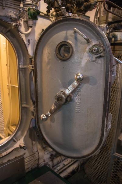 Watertight hatches between compartments in the USS...