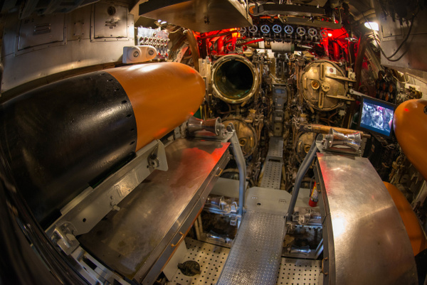 Torpedo in position for loading into the tube. by Willis...