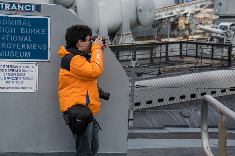Ben on board the stern of the Joe Kennedy, photographing the rear 5 inch turret