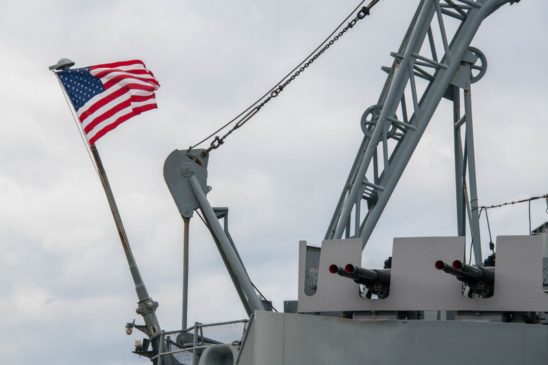 Flag and 40mm anti-aircraft batteries on the fantail of the USS Massachusetts.