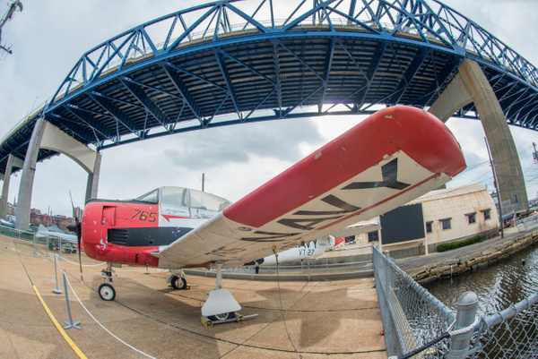 T-28 trainer under the bridge. by Willis Chung