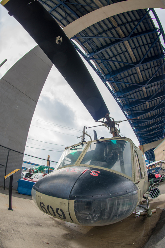 A classic Huey on display under the bridge.