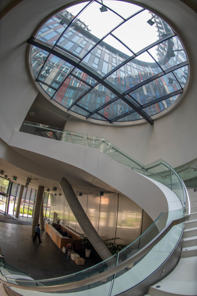 Spiral staircase inside Main Point Karlín. by Willis...