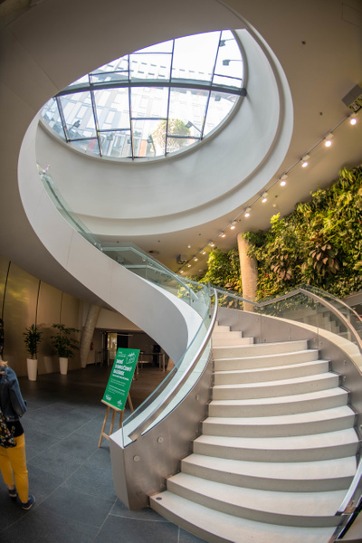 Sweeping spiral staircase inside Main Point Karlín by...
