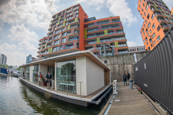 The river side of houseboat, big picture windows. by...
