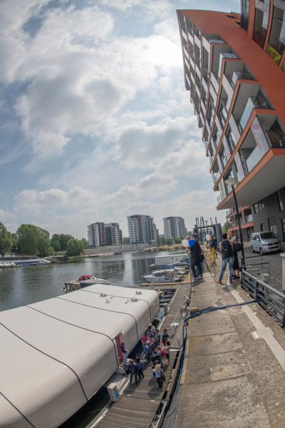 Apartment buildings alongside the PORT X houseboat. by...