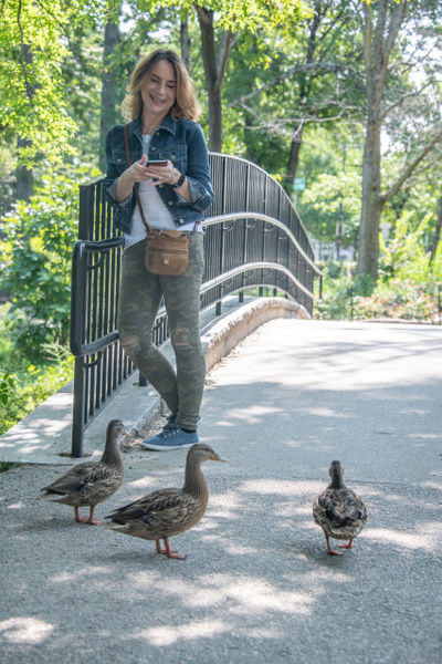 Lady and ducks! by Willis Chung