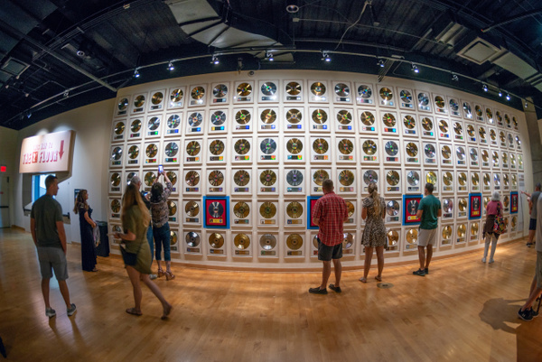 Wall of platinum and gold record awards. by Willis Chung