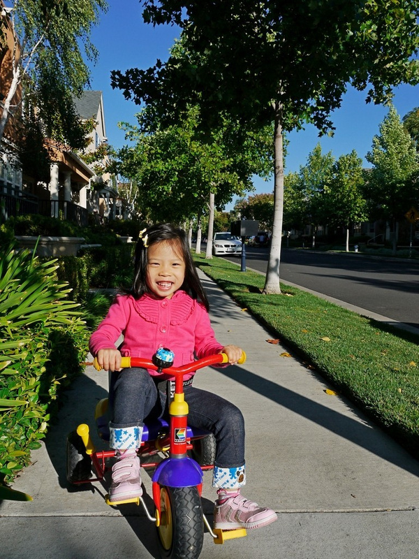 Kyara on her tricycle
