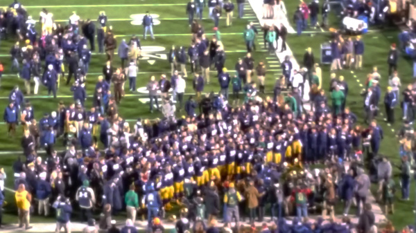 The team joins fellow students and alumni in singing the Alma Mater