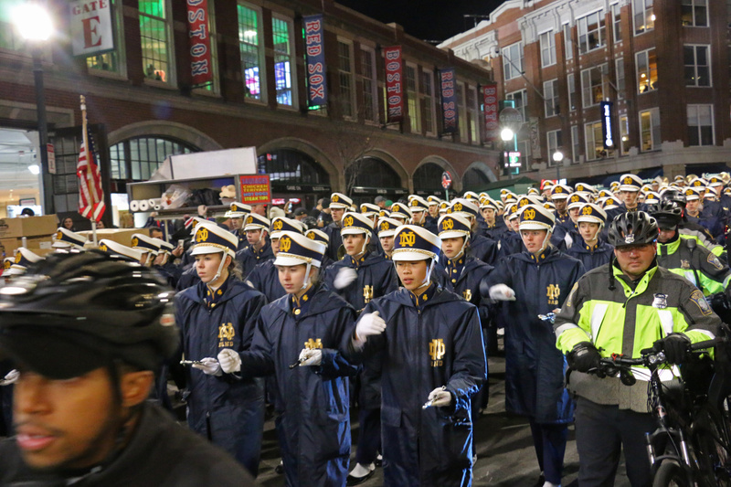 The Band of the Fighting Irish swarming into Fenway Park