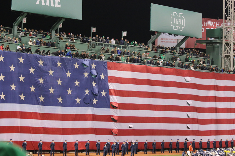 Old Glory drapes the Green Monster as the ND band plays the National Anthem.
