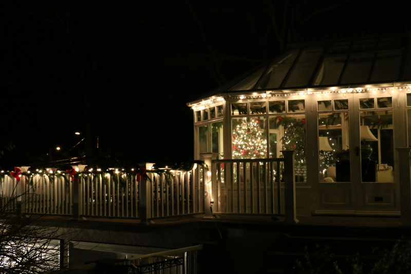 The conservatory illuminated for the holidays