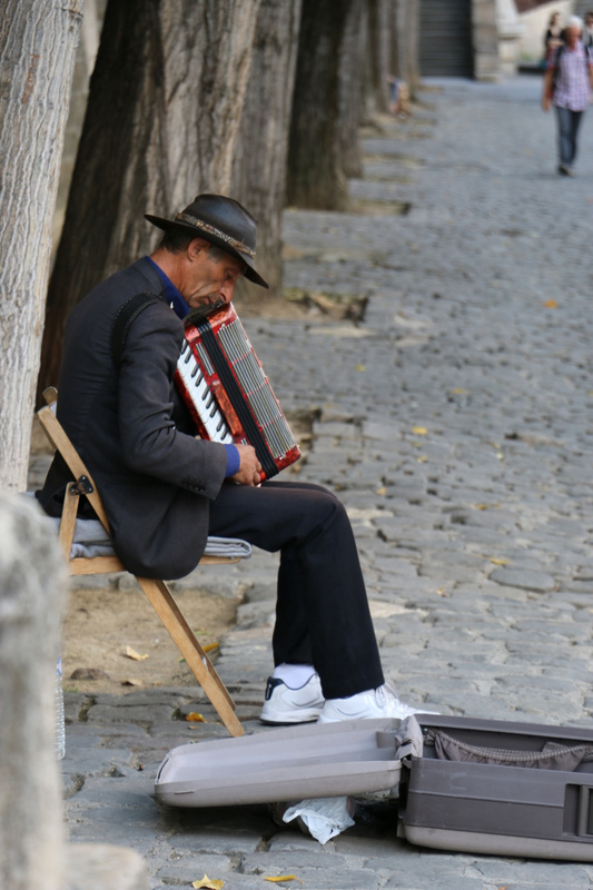 An accordionist by the Seine-The French have a passion for Accordion