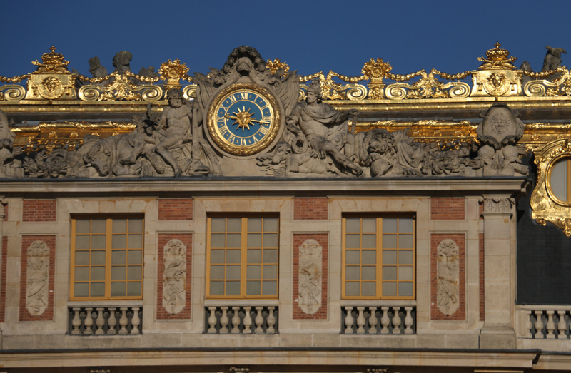Detail-The king's suite. Note the Sun King Motif in the center of the clock.
