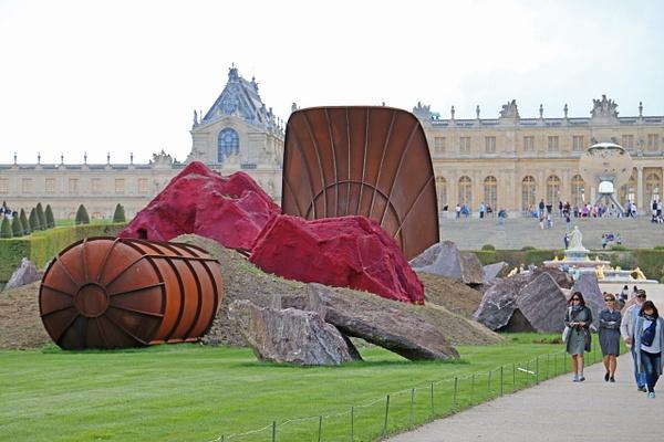 The Gardens of Versailles-Indian-British artist Anish Kapoor's 'Dirty Corner' sculture