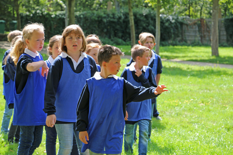 French school children competing in a relay race on Versailles' grounds