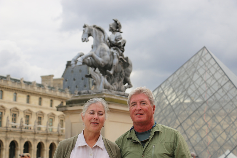 Georgia and Tom in the main courtyard (Cour Napoléon) of the Louvre.