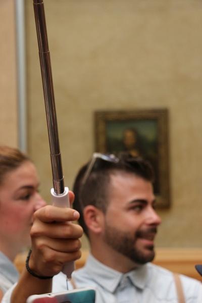 Selfie Sticks were ubiquitous in the Louvre