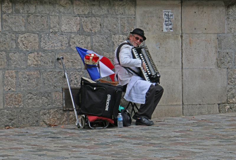 A happy accordianist on Montmarte.
