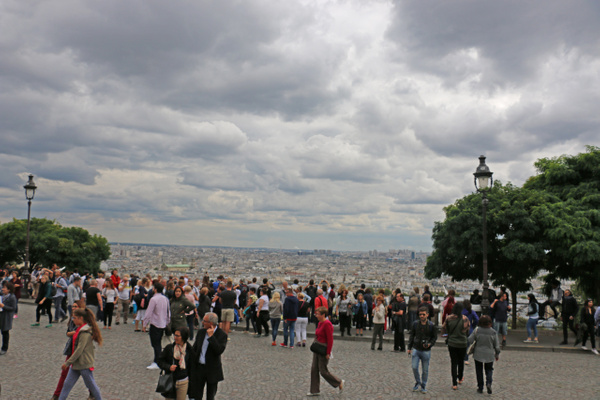 The plaza in front of Sacré-Cœur Basilica offers sweeping views of Paris