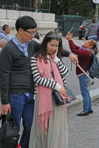 Chinese tourists take a 'selfie', a very common site in Paris